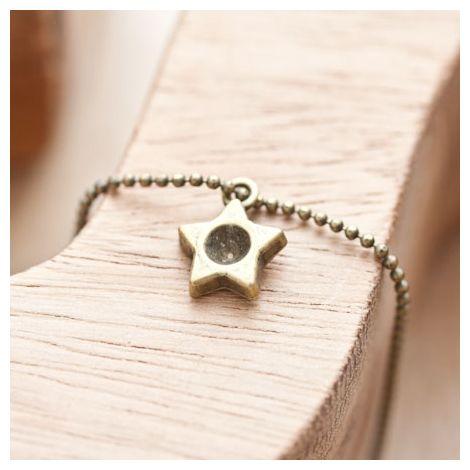 Breloque Petite étoile trou Bronze vieilli