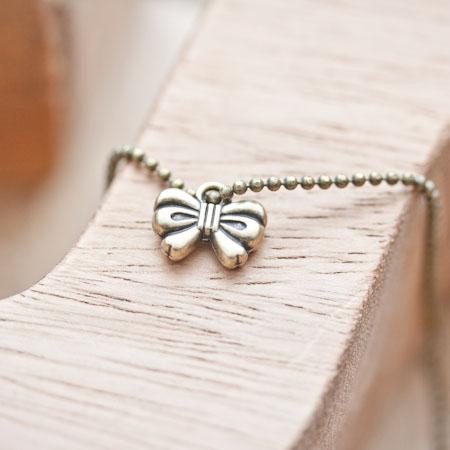 Breloque Mini noeud Bronze vieilli x 10