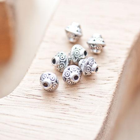 Perle en métal Bicône 7x6.5mm à motifs Argent vieilli