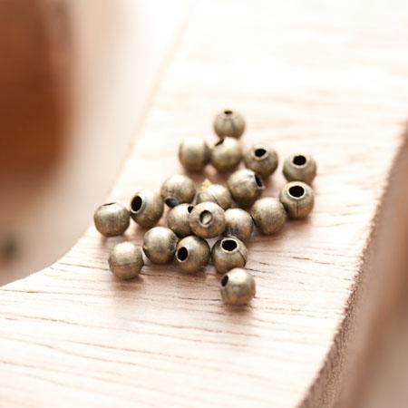 Perle en métal Ronde 4mm Creuse Bronze vieilli x 60