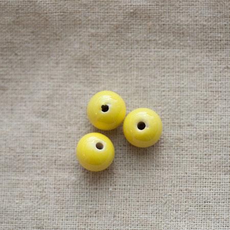Perle porcelaine 13x11.5mm Jaune x 50