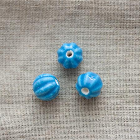 Perle porcelaine 13mm Bleu ciel Relief x 50