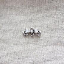 Breloque Petit noeud relief Argent vieilli x 10