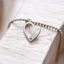 Breloque Coeur mi-plein Bronze vieilli x 10