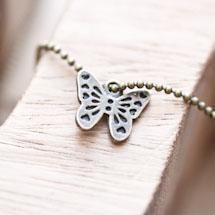 Breloque Joli petit papillon Bronze vieilli x 8