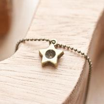 Breloque Petite étoile trou Bronze vieilli x 5