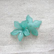 Collerette plastique Fleur pétales pointues Cyan x 50