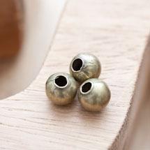 Perle en métal Ronde 10mm Creuse Bronze vieilli x 8