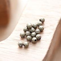 Perle en métal Ronde 4mm Creuse Striée légé Bronze vieilli x 60