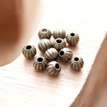 Perle en métal Ronde 6mm Creuse Striée légé Bronze vieilli x 30