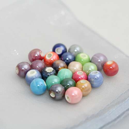 Perle porcelaine 6mm couleurs mixtes x 20