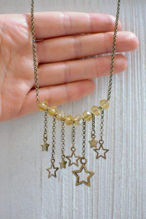 zoom collier étoiles bronze vieilli et jaune